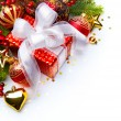 Christmas card with gift boxes and Christmas decorations — Stock Photo #8038316