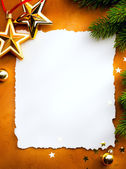 Design a Christmas greeting card with white paper on a red backg — Stock Photo