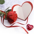Art Valentines day greeting card with red roses and heart - Foto Stock