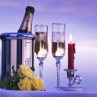Art romantic view with champagne and candles burning in the sky — Stock Photo