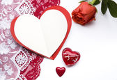 Women's stockings and the heart valentine's greeting card — Stock Photo