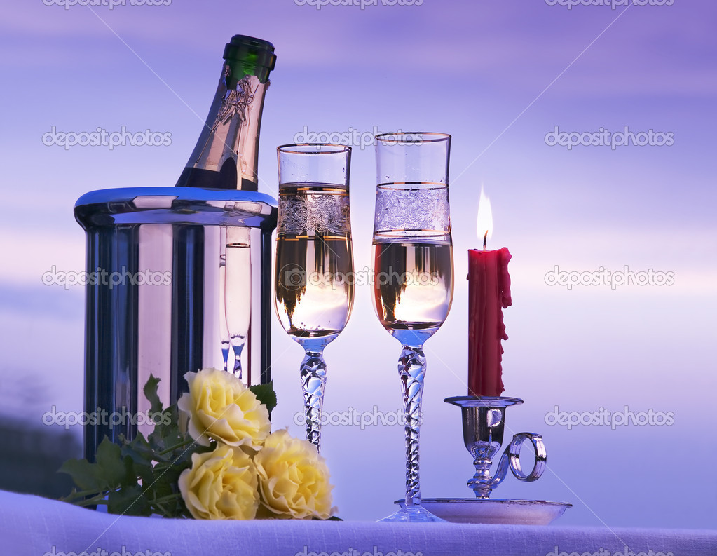 Romantic view with champagne and candles burning in the sky  Stock Photo #8596090