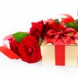 Art Valentine Day golden gift box and red roses on a white backg — Stock Photo