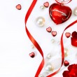 Stockfoto: Valentines greeting card with red roses petals and jewelry haer