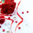 Valentines greeting card with red roses petals and  jewelry hear — Stockfoto