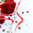 Valentines greeting card with red roses petals and jewelry hear — Stock Photo