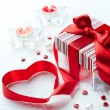 Art Valentine Day Gift box with red ribbon  bow heart - Stock Photo