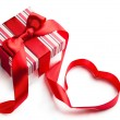 Art gift box with red ribbon in heart shape isolated on white ba — 图库照片