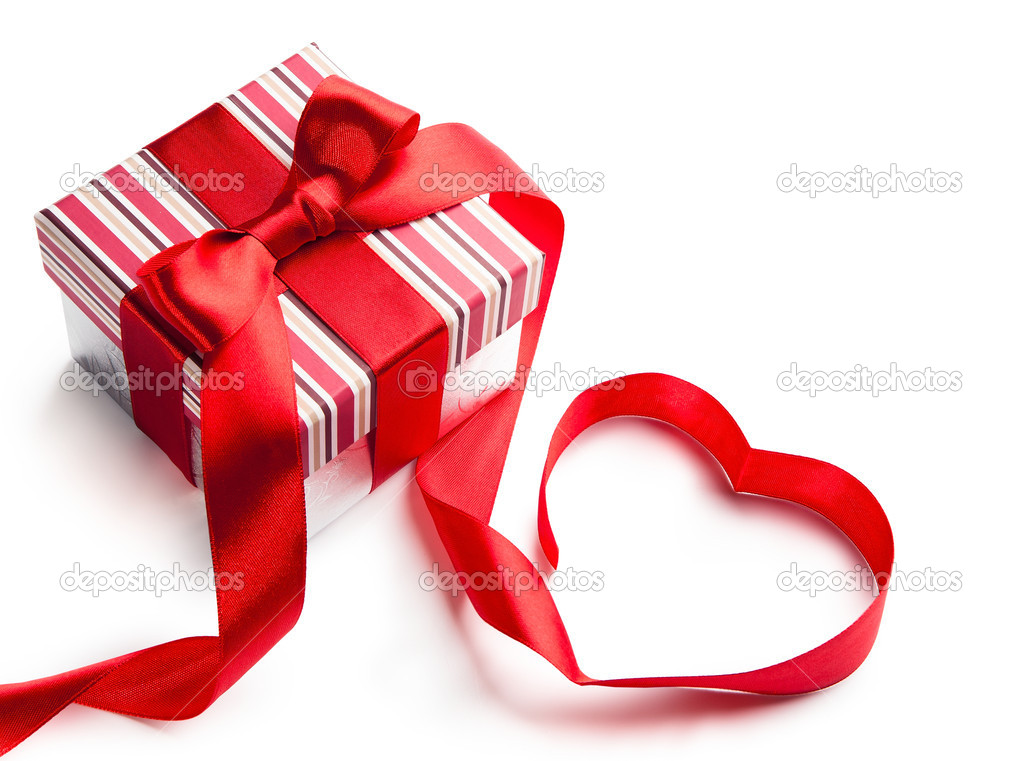 Holiday gift box with red ribbon in the shape of a heart isolated on white background  Stock Photo #8897002