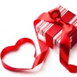 Art gift box with red ribbon in heart shape isolated on white ba — Stock Photo