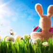 Art Easter teddy bunny and Easter eggs on green grass — Stock Photo #9129154