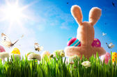 Art Easter teddy bunny and Easter eggs on green grass — Stock Photo