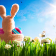 Royalty-Free Stock Photo: Art  Easter teddy bunny and Easter eggs on green grass