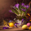 图库照片: Easter basket with spring flowers & Easter eggs