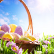 Art Easter basket with Easter eggs on spring lawn — Stock Photo