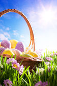 Art Easter basket with Easter eggs on spring lawn — Fotografia Stock