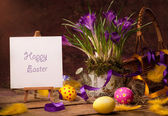 Vintage Easter card, spring flowers on a wooden background — Stock Photo