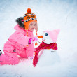 Little girl making snowman — Stock Photo