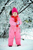 Toddler girl walking at beautiful winter day — Stock Photo