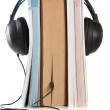 Audiobook conception with headphones and books — Stock Photo