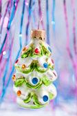 Christmas ornament shaped like a snow covered tree — Stock Photo