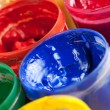 Colourful paints and paintbrushes - Stock Photo