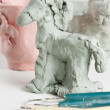 Modelling a clay horse — Stock Photo