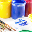 Stock Photo: Colourful paints and paintbrushes