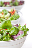 Bowls of fresh green salad — Stock Photo