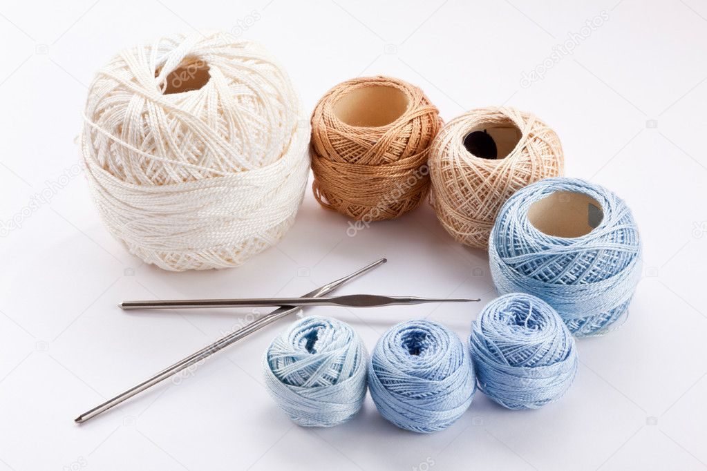 Skeins of colored yarn and crochet — Stock Photo #9876714