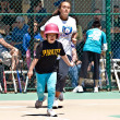 Young Batter Running to First Base — Stock Photo #10162131