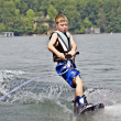 Stock Photo: Young Boy on Wakeboard