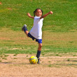 Stock Photo: Girl's Soccer Kicking Ball