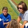 Stock Photo: WomCoaching Girl's Soccer