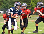 Youth League Football Running the Ball — Stock Photo