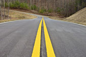 Lines in the Middle of a New Road — Stock Photo