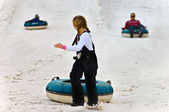 Young Girl Snow Tubing — Stock Photo