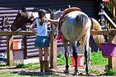 Girl and Horse at Barn — Stock Photo