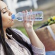 Girl drinking water - Stock Photo