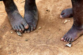 Feet of the african children — Stock Photo