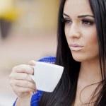 Girl drinking coffee — Stock Photo