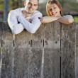Stock Photo: Couple by the fence