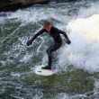 Surfer in the Eisbach river in Munich — Stock Photo #9427065