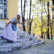 Stock Photo: Girl actress plays role of Cinderella's fairy tale about old m