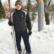 Stock Photo: Elderly mstanding with cross-country skiing in park in winter