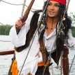 Actor Jack Sparrow in the form of a rope ladder on a sailing ship — Stock Photo
