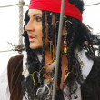 Actor Jack Sparrow in the form of a rope ladder on a sailing ship — Stock Photo #8521050