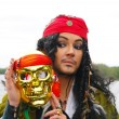 Actor in the guise of Jack Sparrow pirate with a mask on a sailing ship — Lizenzfreies Foto