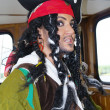 Actor in the guise of Jack Sparrow in the wheelhouse of a sailing ship — Stock Photo
