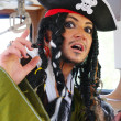 Stock Photo: Actor in guise of Jack Sparrow in wheelhouse of sailing ship
